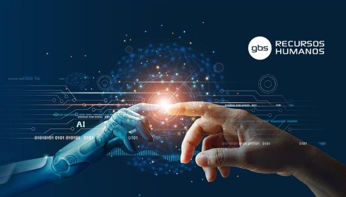 Mano de un robot y de una persona para representar el empleo en inteligencia artificial